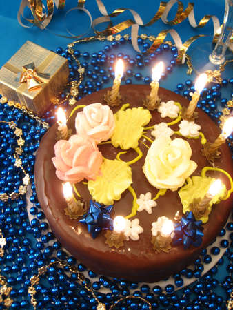 celebratory table (cake and candles, two glasses with champagne, gift boxes) on blue  Stock Photo - 2222327