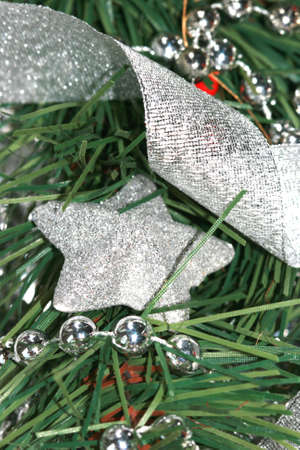 silver decoration star on Christmas tree Stock Photo - 2222329