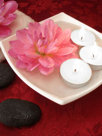 stone wash: Spa essentials (candles, flowers on water, towel and stones)