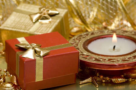 gift boxes and burning candle  Stock Photo - 2241423