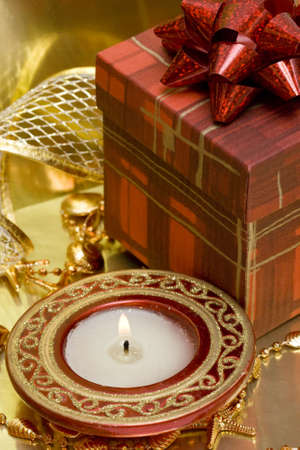 burning candle and gift box Stock Photo - 2241425