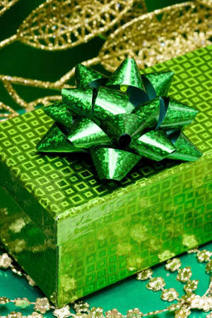 green gift box and golden celebration leaves  photo