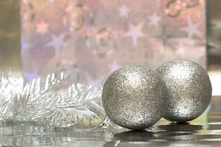 Christmas balls with package on silver background Stock Photo - 2263717