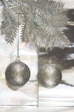 Christmas balls with package on silver background  Stock Photo - 2263726