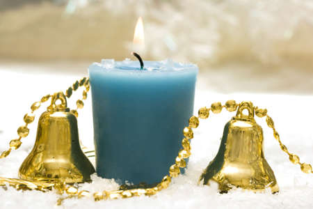 festive new-year candle with handbells  photo