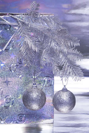 Christmas balls with package on blue background Stock Photo - 2297617