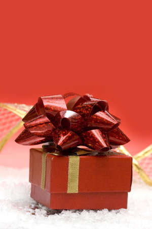 heap snow: gift box on red background  Stock Photo