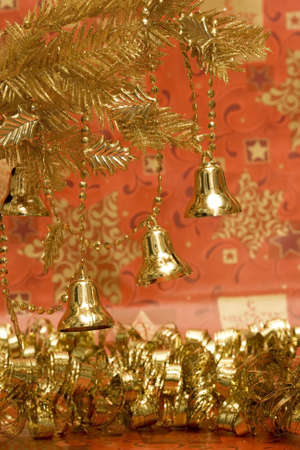 new-year handbells and Christmas tree on red background Stock Photo - 2420550