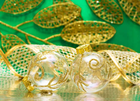 golden Christmas ball on green background  photo