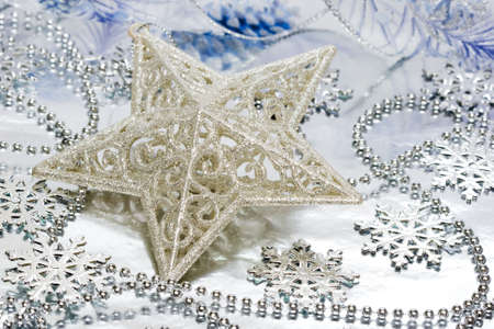 Star decoration on silver background Stock Photo - 2456446