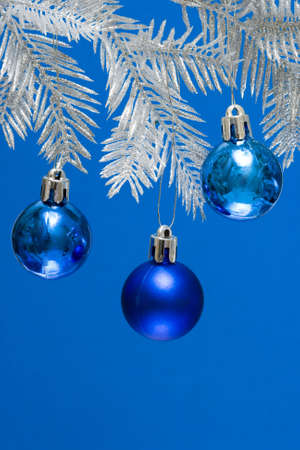 blue Christmas balls on silver tree  photo