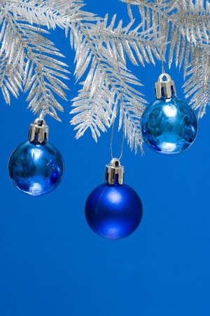 blue Christmas balls on silver tree  photo
