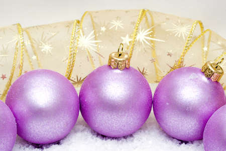 Pink Christmas balls in snow  photo