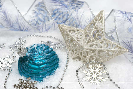 blue festive decoration and star on snow  Stock Photo - 2456492