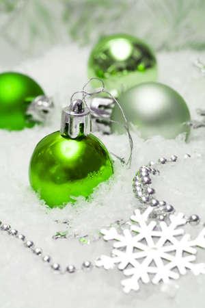 green festive decoration on snow  Stock Photo
