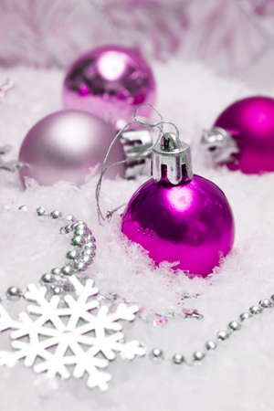 pink festive decoration on snow  photo