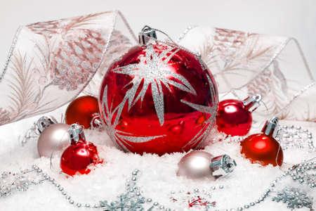 red festive balls on snow