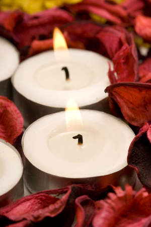 row of candles with red rose petals (shallow DOF)  photo