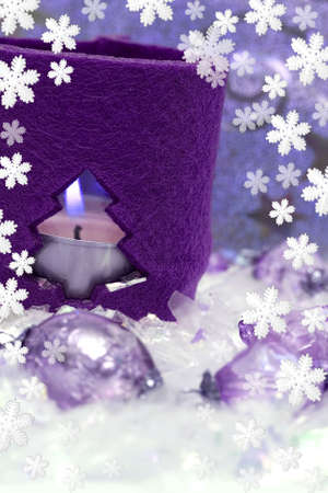 festive new-year candle with snowflakes  photo