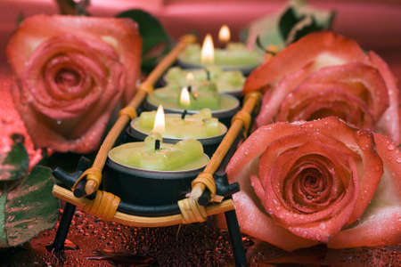 row of green candles with roses  Stock Photo - 2532267