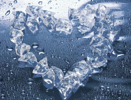 heart from ice on blue background  Stock Photo - 2532282