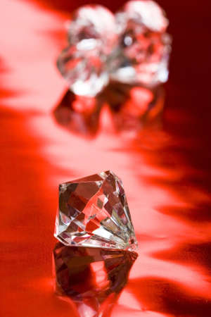 beautiful diamond crystal on red background  Stock Photo - 2532296