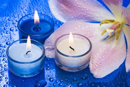 Candles with flower on blue background Stock Photo - 2532265