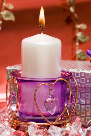 violet candle with heart and gift box  photo