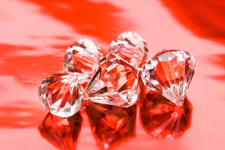 beautiful diamond crystals on red background Stock Photo - 3088792
