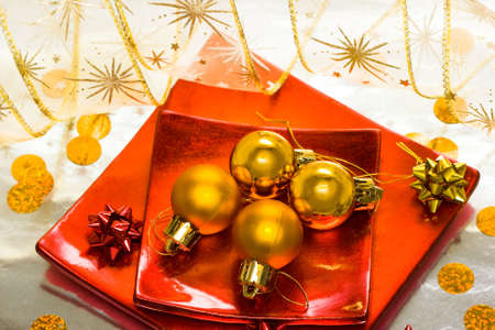 golden Christmas balls on red plate  photo