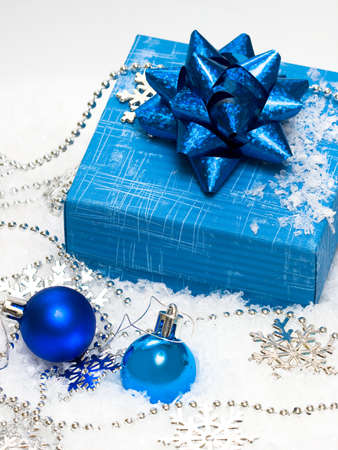 festive balls with gift box on snow Stock Photo - 3173958