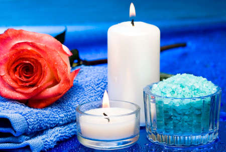 Spa essentials (candles, towel, salt and flower)  photo