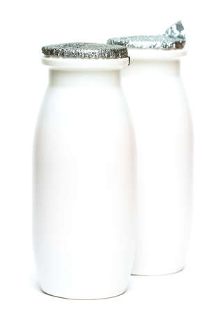 Two jars with milk over white  Stock Photo - 3173806
