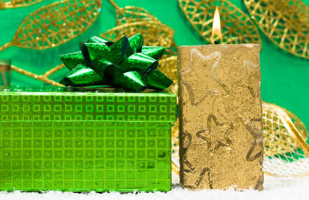 festive candle with green present  photo