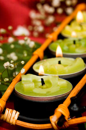 Row of green candles and white flowers  photo