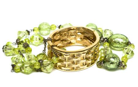 golden bracelet with beads isolated on white background  photo