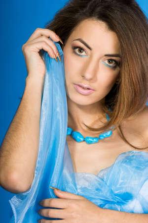 beautiful woman with blue silk  photo
