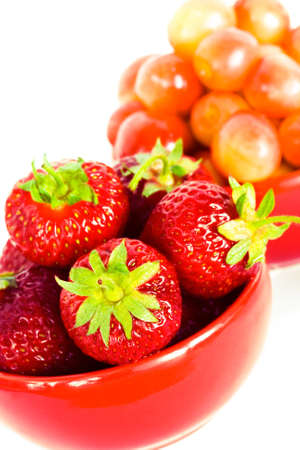 strawberry and chery on red plates Stock Photo - 3297144