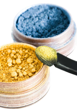 yellow and blue make-up eyeshadows and cosmetic brush