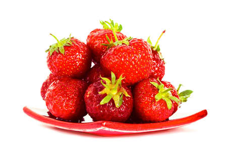 strawberry on red plate over white background  photo