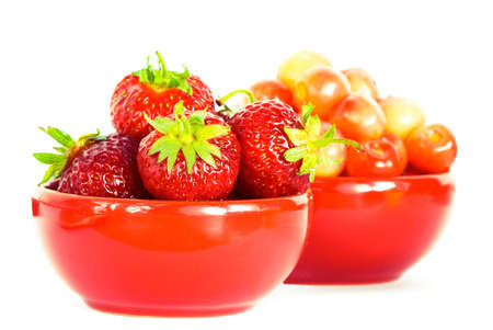 strawberry and chery on red plates  photo