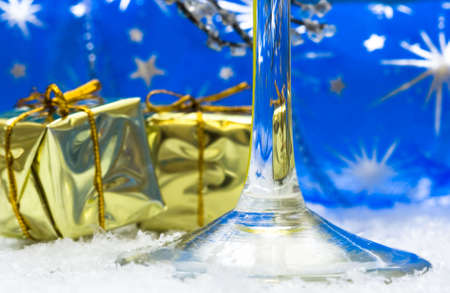 glass with champagne and gift boxes  photo