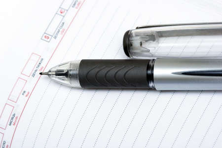 autograph: black pen with notebook on white  Stock Photo