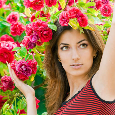 beautiful woman in garden with roses  photo
