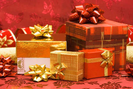 red and golden gift boxes with bow  Stock Photo - 3423826