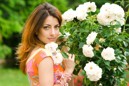 beautiful woman in garden with roses  Stock Photo