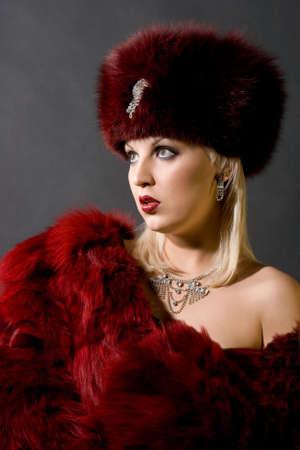 girl in a red fur cap Stock fotó