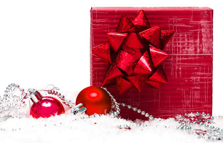 festive balls with gift box on snow Stock Photo - 3708175