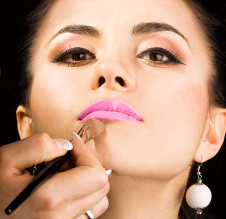 cosmetologist doing make-up for model with brush  Stock Photo - 3709896