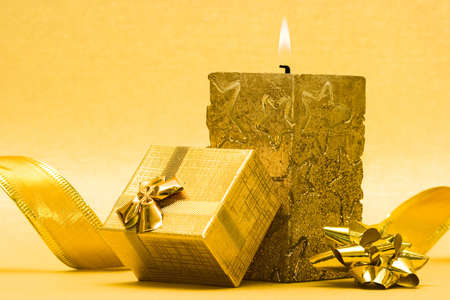 golden candle and gift box  Stock Photo - 3916653